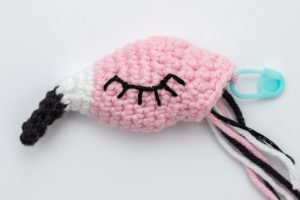 Embroidered eyes crochet flamingo